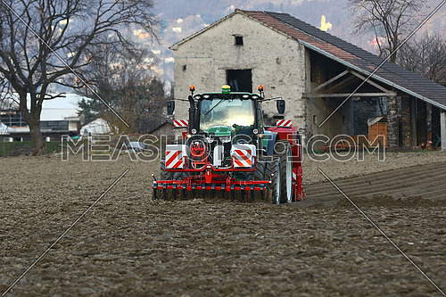 Agricultural tractor at work in a field