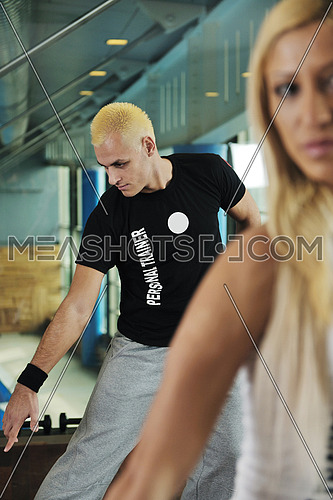 woman exercise fitness and get nice fit shape in fitness sport club indoor