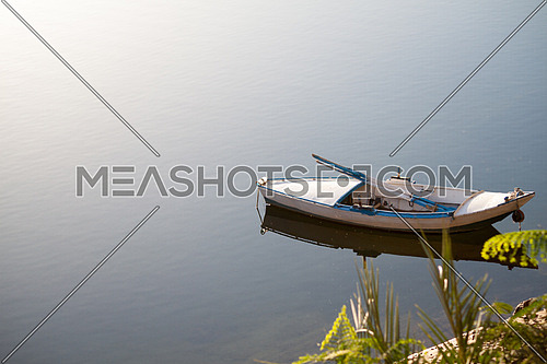 a wooden rowing boat in River Nile