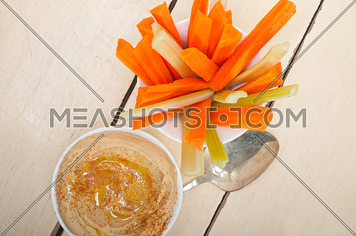 fresh hummus dip with raw carrot and celery arab middle eastent healthy food