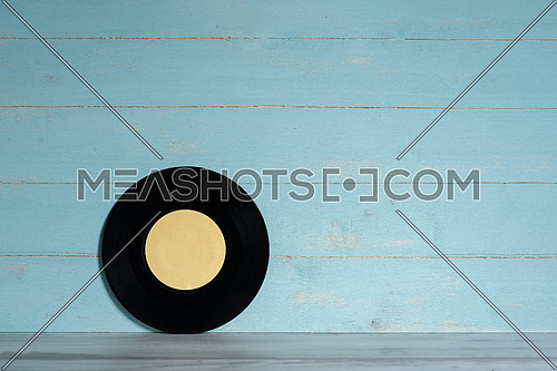 Vinyl record on wooden background,vintage style