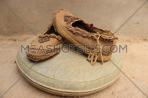 close up for pair of old amazigh brown women shoes.