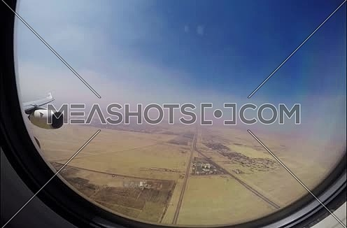 Etihad airways airplane during approach in Cairo passenger view