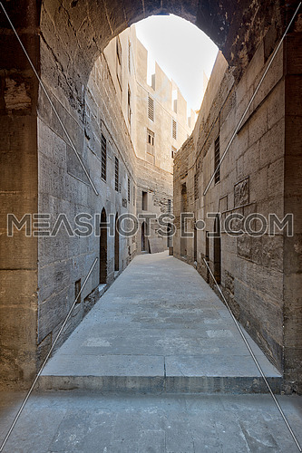 Narrow passage with old grunge stone walls leading to Sultan Hasan Mosque, Cairo, Egypt
