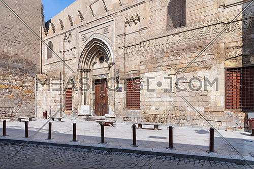 Facade of theological school and Mausoleum of Sultan Qalawun, Mamluk era historic building, at Moez Street, Gamalia district with no visitors during Covid-19 lockdown period, Old Cairo, Egypt