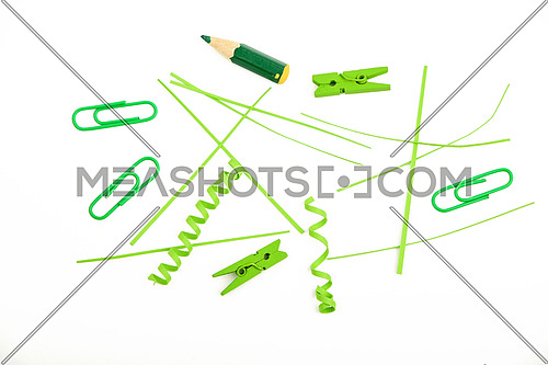 Small things matter, mixed colorful green paper pieces and wooden painted clothespins isolated on white background