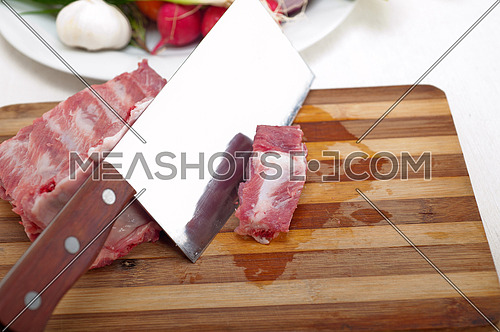 fresh pork ribs with vegetables and herbs ready to cook