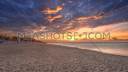 Landscape of beautiful sea and beach sunrise, seascape and hill mountain on backgrond, Simeri Mare, Calabria, Southern Italy