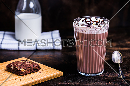 Chocolate Milk drink with whipped cream and chocolate syrup