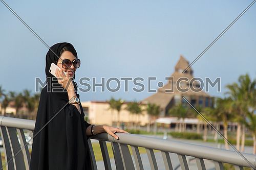 Saudi lady on a call at day