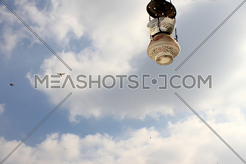 old Islamic lamp against Cloudy Sky