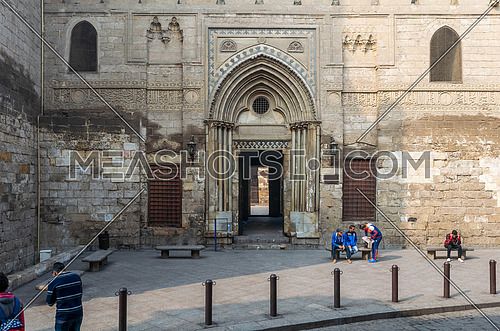 Cairo, Egypt- December 12 2015: Entrance of theological school and Mausoleum of Sultan Qalawun, Moez Street