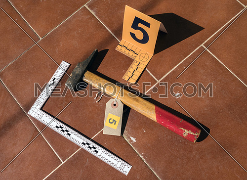 Hammer on the crime scene, numbering in evidence, conceptual image