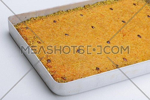 Turkish pastry kadaif close-up ,ready for syrup, background