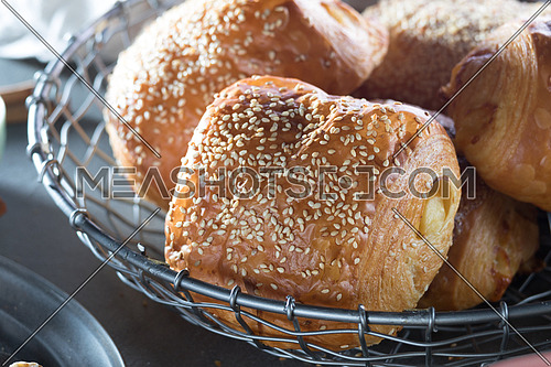 Pastry with sesame in a basket