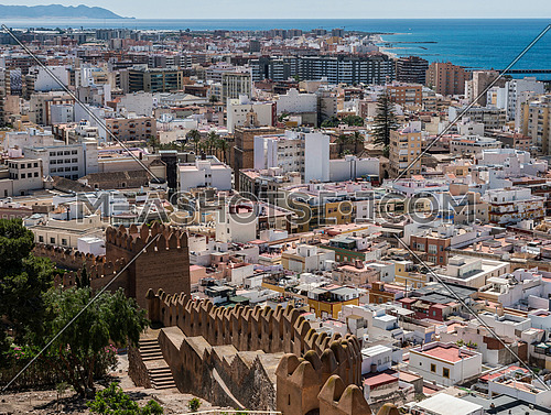 Almeria, SPAIN - May 20: View from the fortress of Moorish houses and buildings along the port of Almeria, Andalusia, Spain