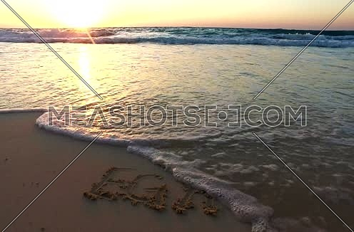 Long Shot for (This is egypt) sentence written on sand