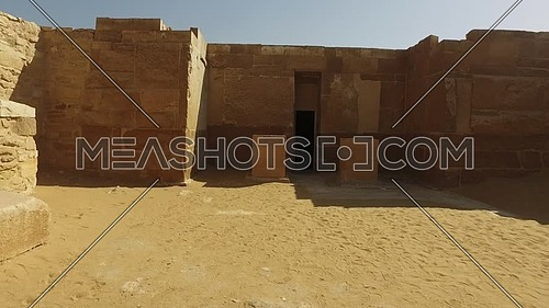 Walkthrough ancient pharaonic ruins in Saqqara Area at day.