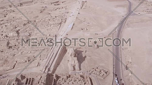 Reavel Shot Drone for The Sphinx and Menkaure Pyramid and Khafre Pyramid then reavels Khufu Pyramid in background in Giza at day