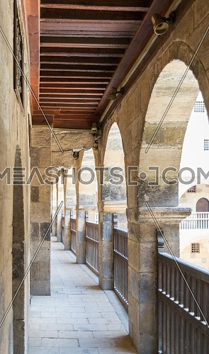 One of the arcades surrounding the courtyard of old historic public caravansary building - Wikala Bazaraa - Medieval Cairo, Egypt