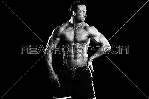 Muscular Mature Man Posing In Studio - Isolated On Black Background
