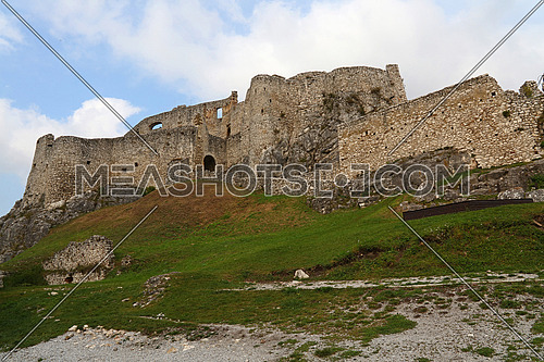 Low angle view of Spissky hrad or Spis Castle ruins in Slovakia, one of the largest castle sites in Central Europe, built in 12th century, summer day