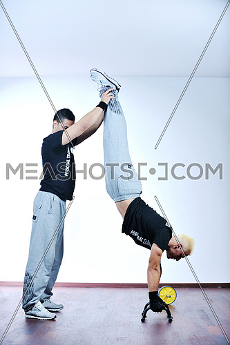 man fitness personal trainer in sport club
