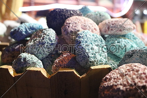 Pile of colorful bathing stones at an oriental shop spa