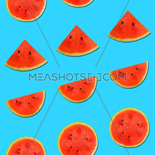 Seamless pattern of fresh red ripe juicy watermelon round cut wedges on vivid blue background