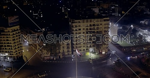Drone Left of shot for Tahrir Square showing National Flag Pole in Cairo at night