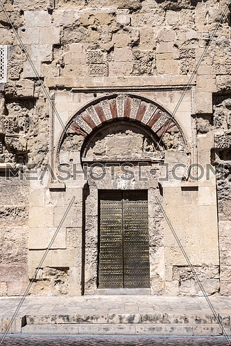 Cordoba, Spain - July 9, 2017: Bab al-Wuzara gate. of the viziers. of San Esteban, the oldest decorative ensemble of Andalusian architecture, Cordoba, Spain