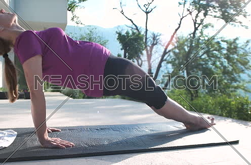 Fitness Woman Doing Stretching in front of mansion
