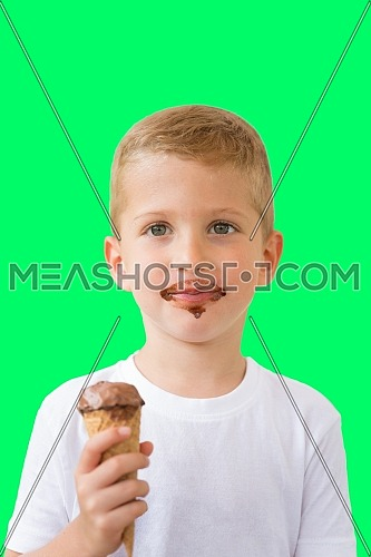 Baby boy kid hold chocolate ice cream in waffles cone isolated on green background with free text copy space
