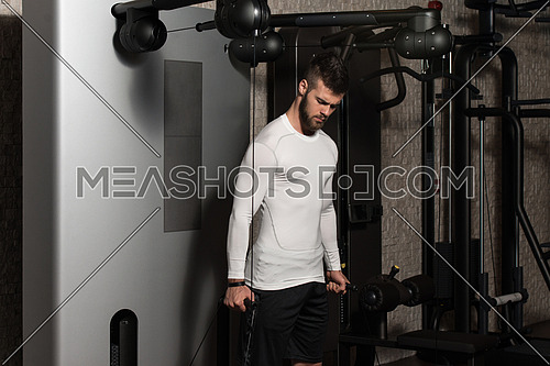 Young Handsome Man Exercise Biceps On Machine