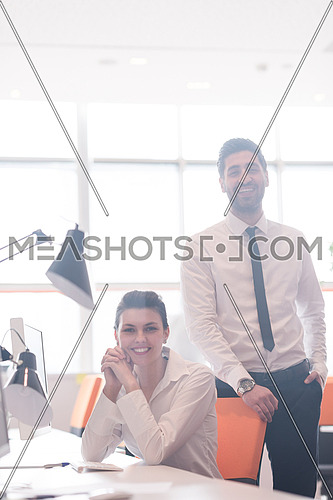 startup business couple portrait at modern bright office interior