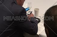Close shot for a business man wearing a suit and taking notes.