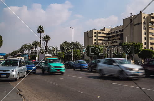 Zoom In Shot for traffic at Salah Salim Street showing Le Meridien Hotel in background at Daytime