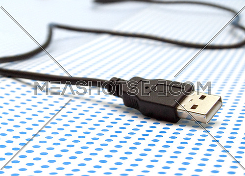 usb cable on dotted background