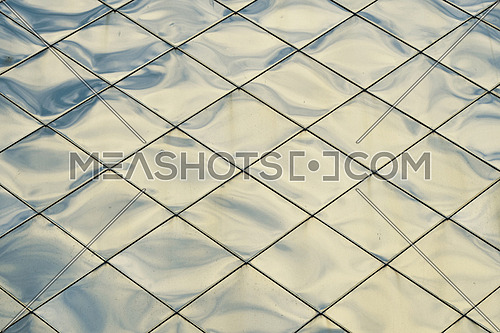 Silver blue metal shiny vivid rooftop tile panels texture background with reflections and highlights