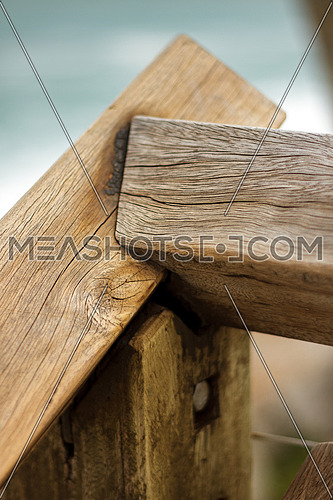 Connected wooden logs from a stair case in an outdoor setting