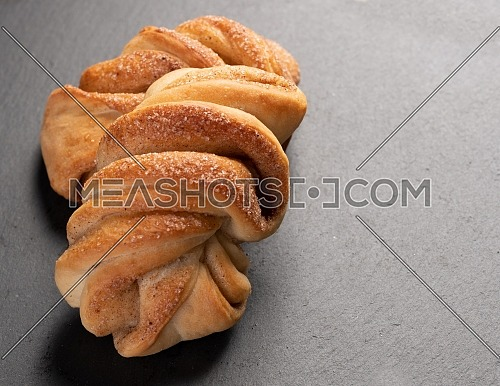 sweet, homemade cake with cinnamon on dark background with copy space