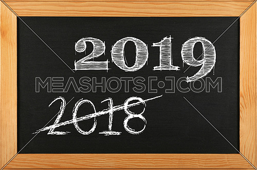 Black school chalkboard blackboard sign in brown wooden frame with 2019 and 2018 strikethrough chalk text