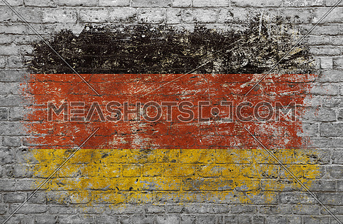 Grunge distressed flag of Germany painted on old weathered grey brick wall