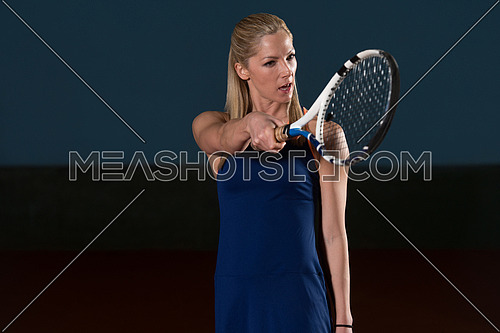Female Tennis Player With A Racket Indoors - Angry Tennis Player Threatens