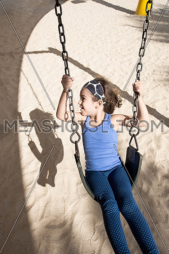 girl on a swing in a park