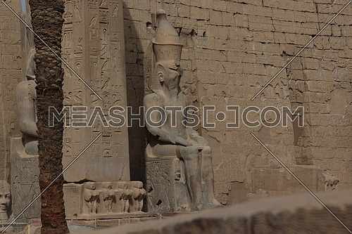 a photo for Luxor temple showing the statues of the Pharaohs , architecture , in Luxor city , Egypt