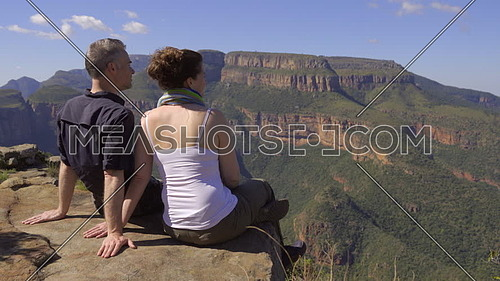 Couple sits and admires the view of Blyde river Africa