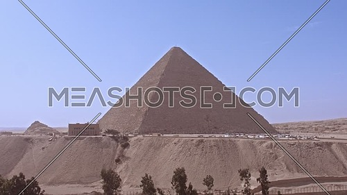 Fly over shot for The Great Pyramid of Khufu in background in Giza at day