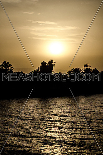 A silhouette of the Nile river during sun set