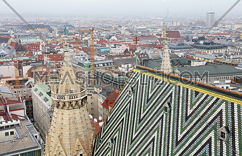 View of Vienna city over roof towers of St Stephen Cathedral (Stephansdom), day, high angle view